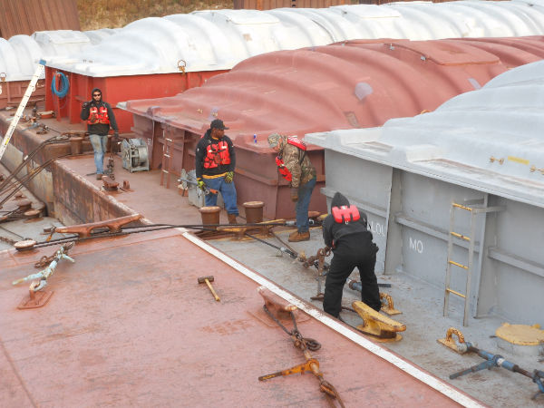 Workers on barge